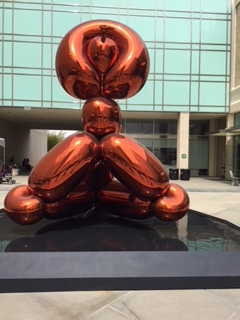 Balloon Monkey (Orange), by Jeff Koons